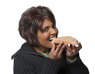 eating slice of bread