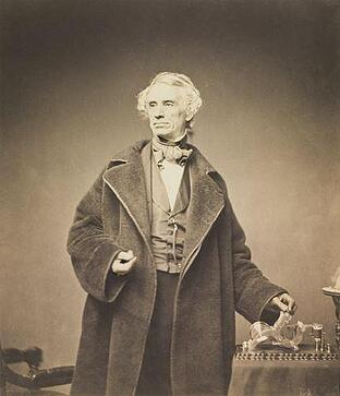 412px-Samuel_Morse_with_his_Recorder_by_Brady_1857