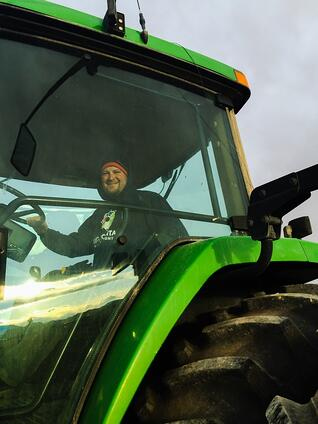 farmer_in_tractor_web