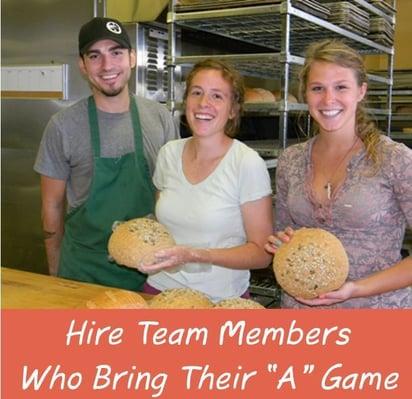 bakery employees smiling in bakery
